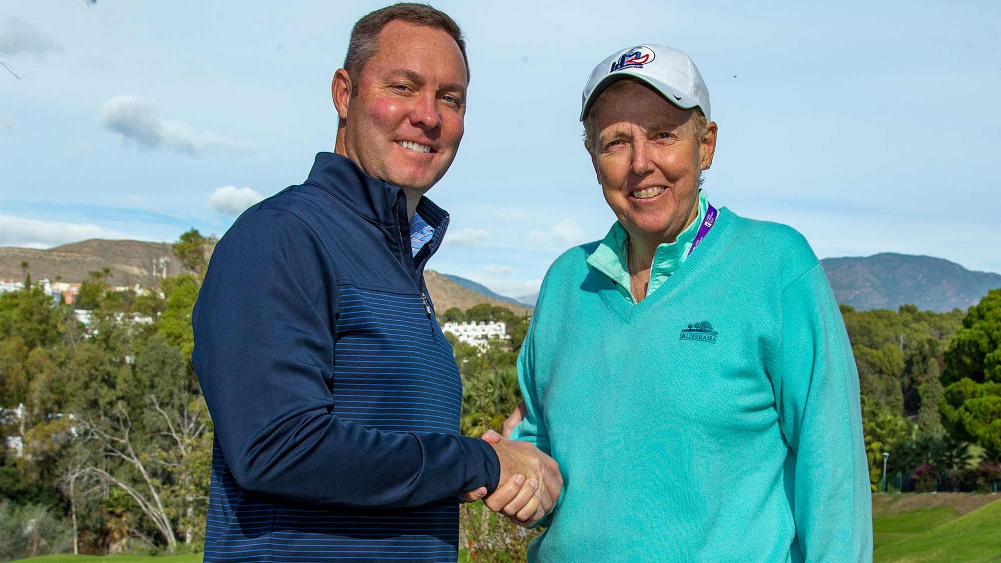 LPGA Commissioner Mike Whan and the Ladies European Tour's Board Chair Marta Figueras-Dotti shake hands on Tuesday following the LET's Annual Membership Meeting in Spain