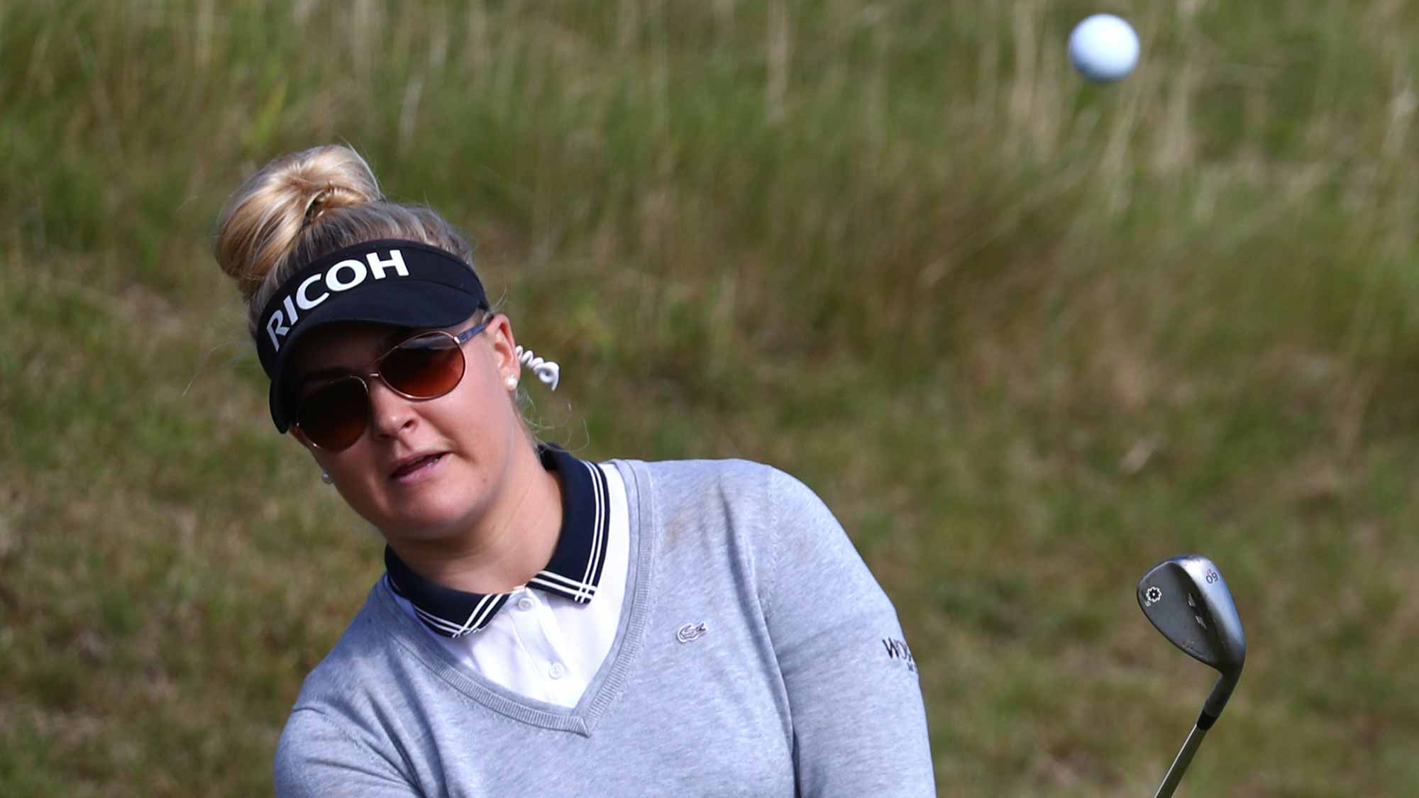 Charley Hull of England chips during a practice round prior to the Ricoh Women's British Open at Kingsbarns Golf Links