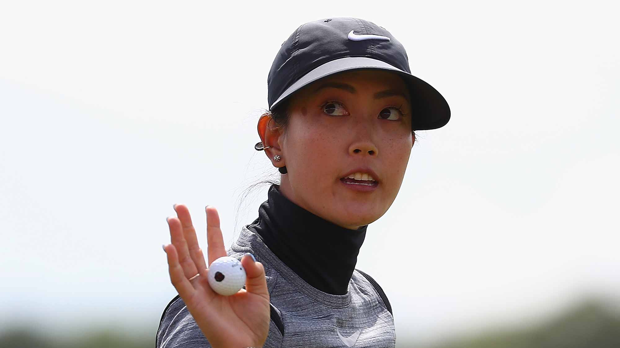 Michelle Wie of the United States celebrates her putt on the 18th green during the first round of the Ricoh Women's British Open at Kingsbarns Golf Links