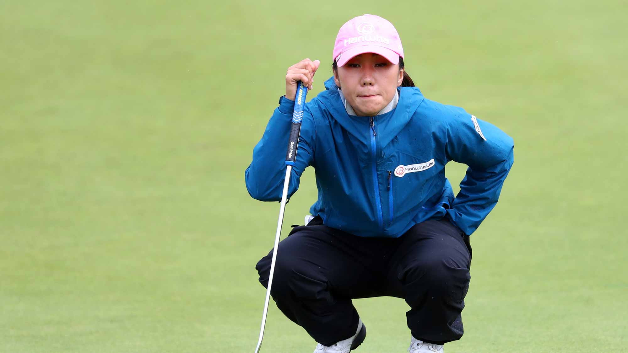 In-Kyung Kim of Korea lines up a putt on the 4th green during the third round of the Ricoh Women's British Open at Kingsbarns Golf Links