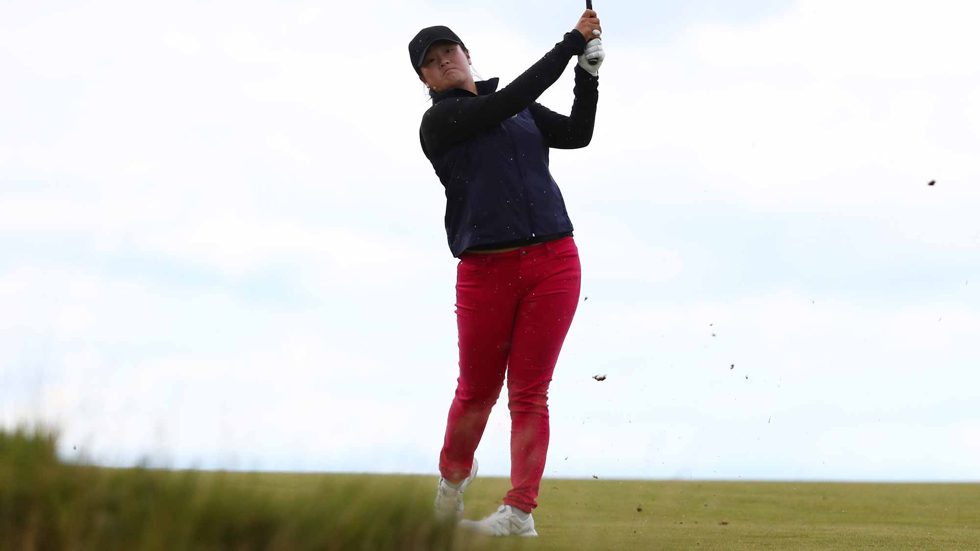 Angel Yin of the United States hits her second shot on the 4th hole during the third round of the Ricoh Women's British Open at Kingsbarns Golf Links