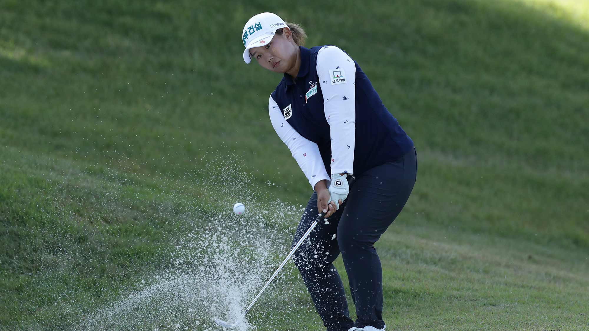 Hee Won Na of the Republic of Korea plays a bunker shot on the fifteen hole during Round 2 of 2019 BMW Ladies Championship at LPGA International Busan on October 25, 2019 in Busan, Republic of Korea