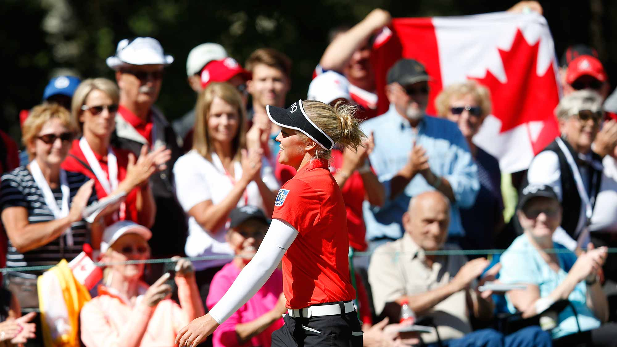 Brooke Henderson reacts to the fans at the end of her second round of the Canadian Pacific Women's Open at Priddis Greens Golf and Country Club