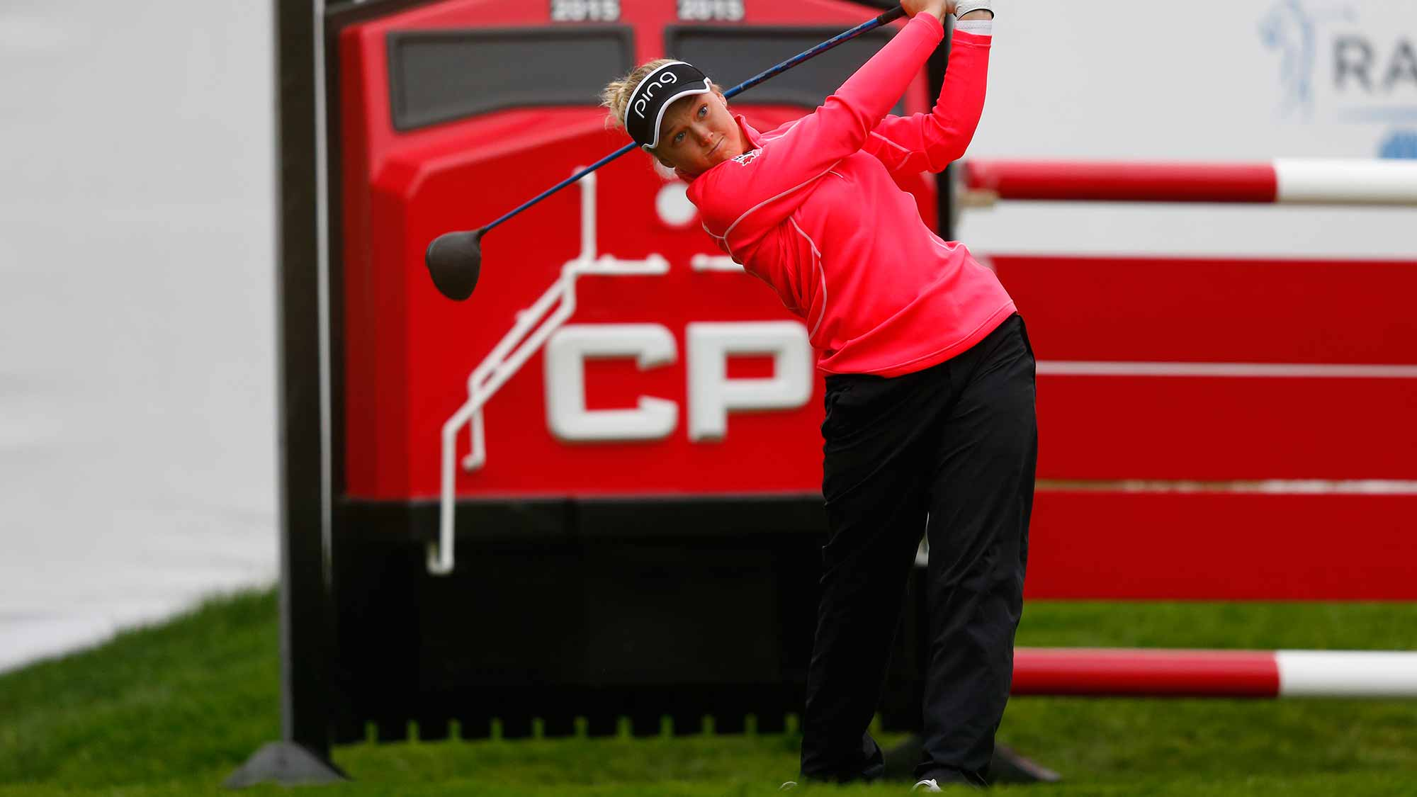 Brooke Henderson of Canada tees off on the first hole during the third round of the Canadian Pacific Women's Open at Priddis Greens Golf and Country Club