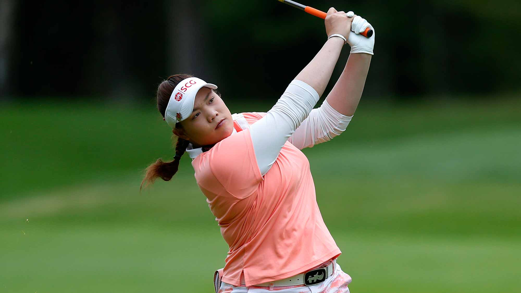Ariya Jutanugarn of Thailand hits to the green on the 1st hole during the third round of the Canadian Pacific Women's Open at Priddis Greens Golf and Country Club