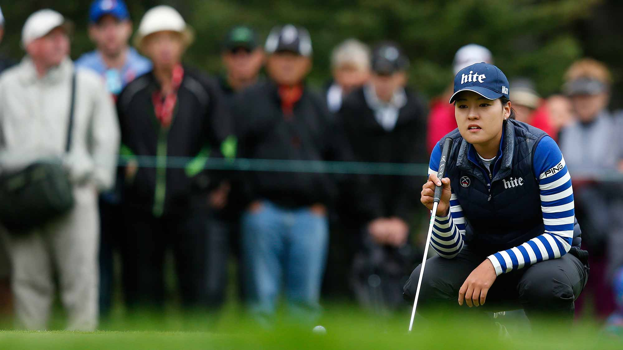 In Gee Chun of South Korea lines up her putt on the first hole during the final round of the Canadian Pacific Women's Open at Priddis Greens Golf and Country Club