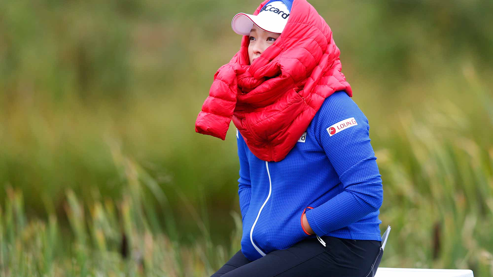 Ha Na Jang of South Korea tries to keep warm in the cold morning weather on the 3rd tee box during the final round of the Canadian Pacific Women's Open at Priddis Greens Golf and Country Club
