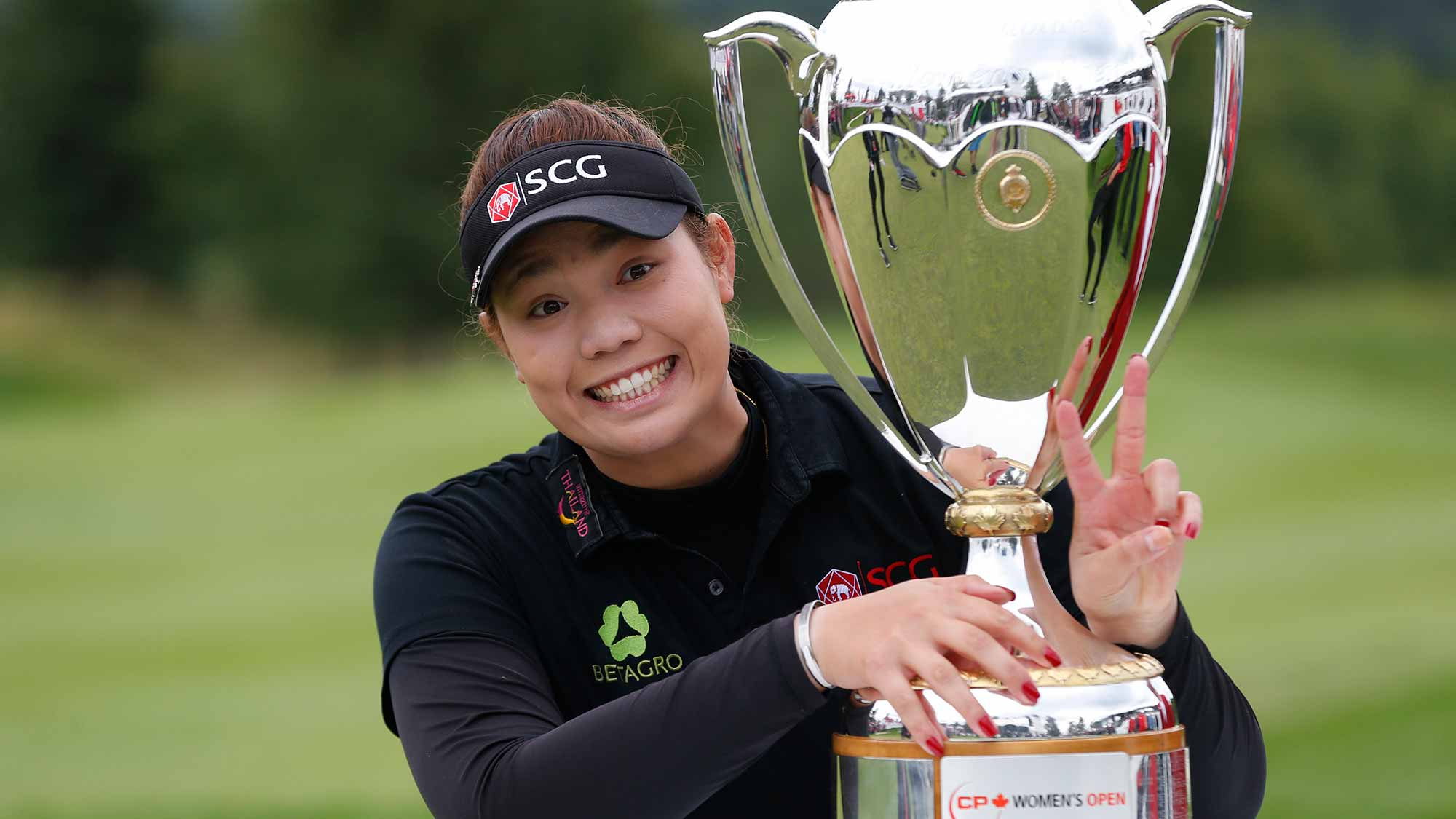 Ariya Jutanugarn of Thailand poses with the Canadian Pacific Women's Open trophy after she won the event at Priddis Greens Golf and Country Club
