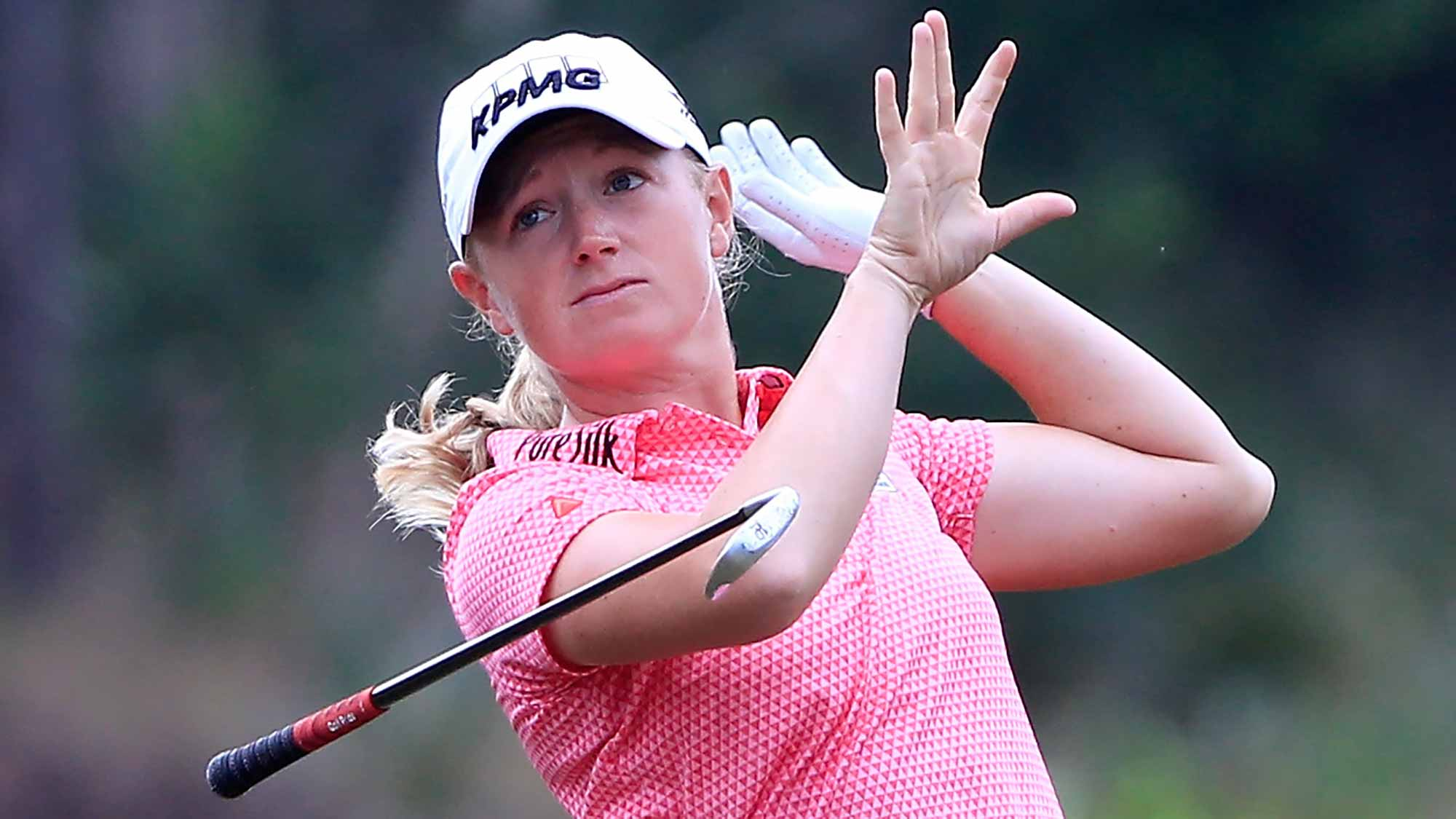 Stacy Lewis of the United States loses her club after a shot on the third hole during the third round of the CME Group Tour Championship at Tiburon Golf Club