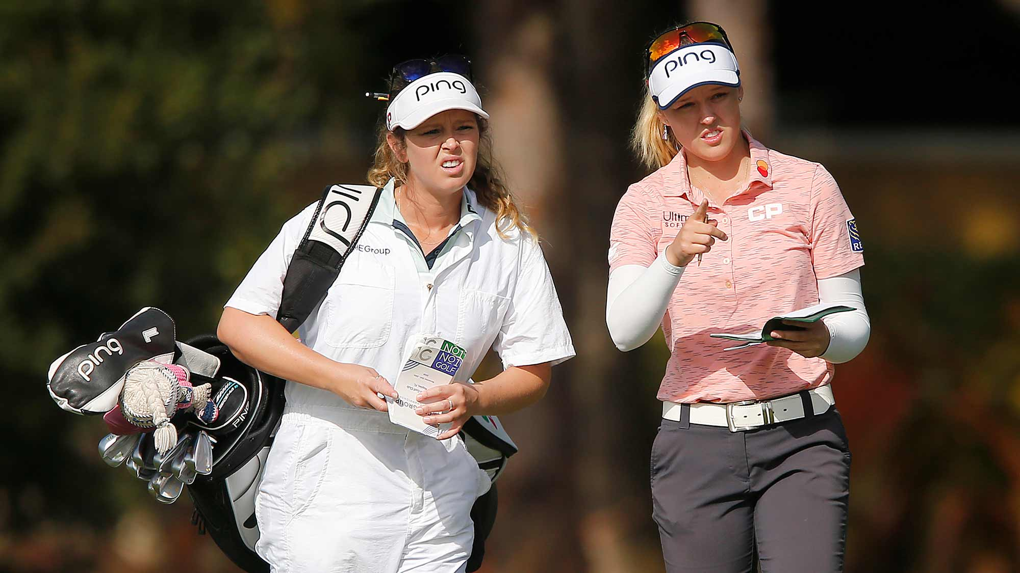 Brooke Henderson of Canada talks with her caddie on the first hole during the final round of the CME Group Tour Championship at Tiburon Golf Club on November 24, 2019 in Naples, Florida