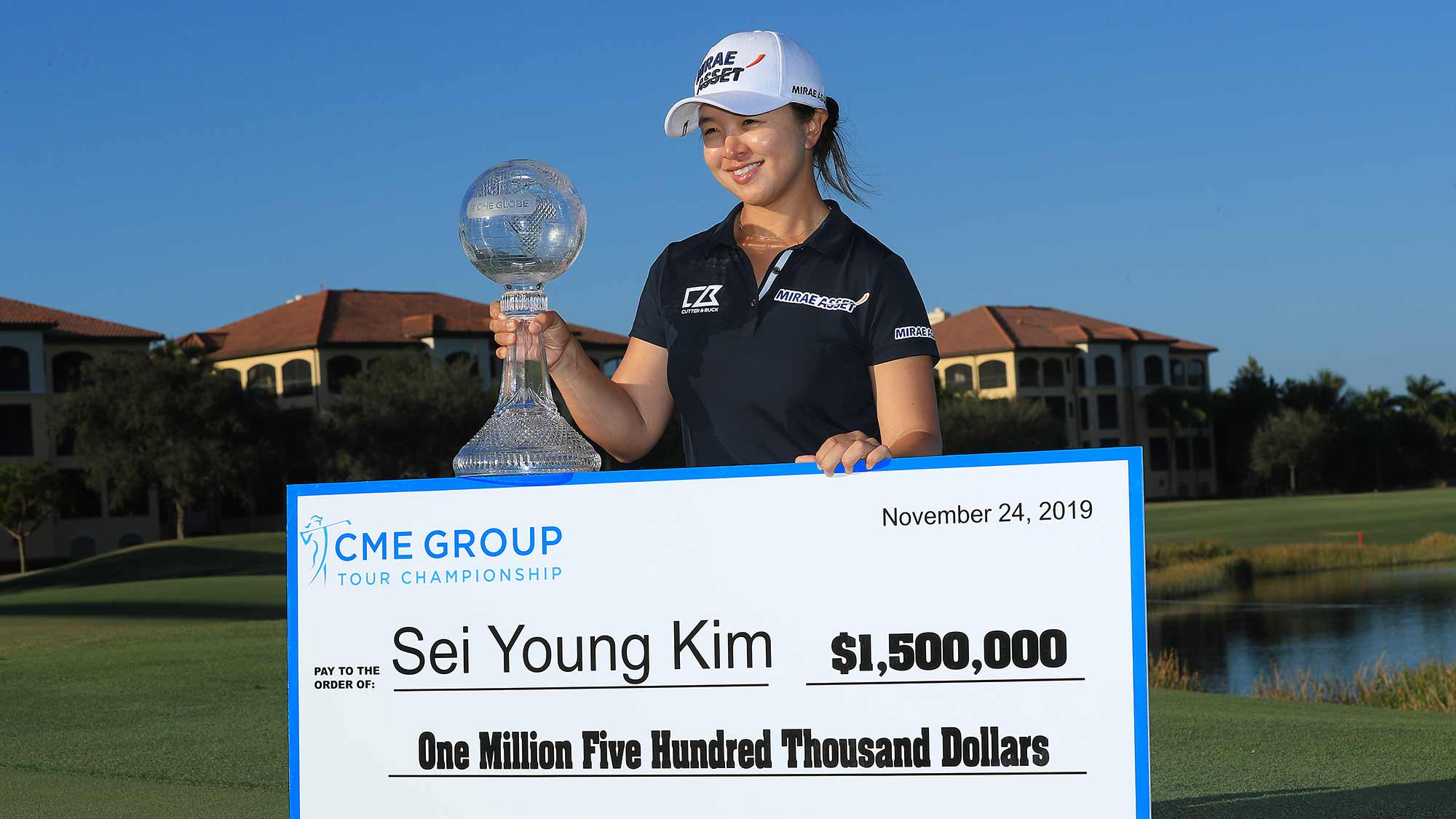 Sei Young Kim of South Korea poses with the CME Globe trophy and winner's check after winning the CME Group Tour Championship at Tiburon Golf Club on November 24, 2019 in Naples, Florida.