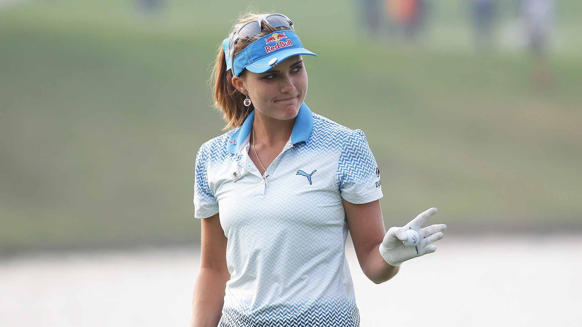 Lexi Thompson of United States reacts after a putt on the 18th green during round four of the LPGA KEB Hana Bank