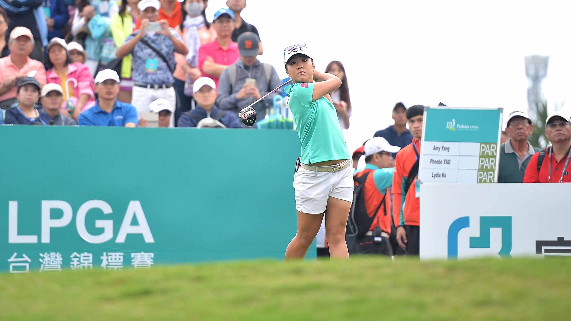 Lydia Ko of New Zealand plays the shot during the round one of 2015 Fubon LPGA Taiwan Championship at Miramar Golf & Country Club