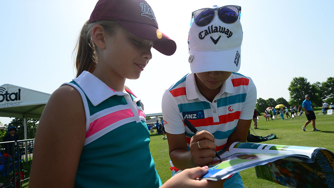 Lydia Ko signing an autograph for a young fan during her Tuesday Practice Round