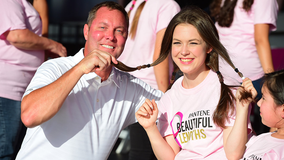 LPGA Commissioner Mike Whan with a hair donor at the Pantene Beautiful Lengths Event