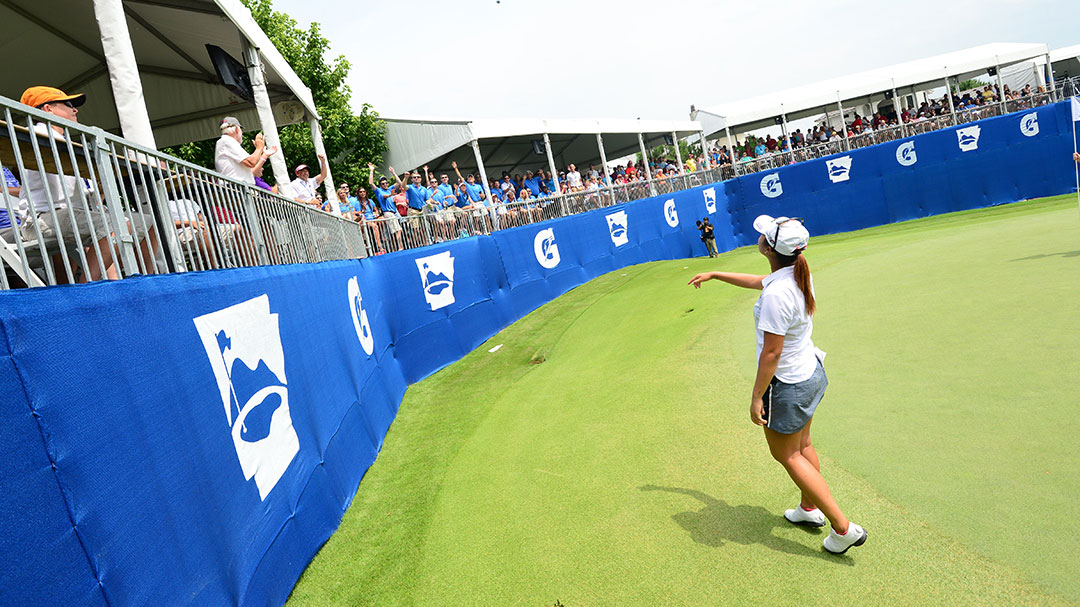 Lydia Ko throws a golf ball into the crowd at the Gatorade Loudest Hole on Tour