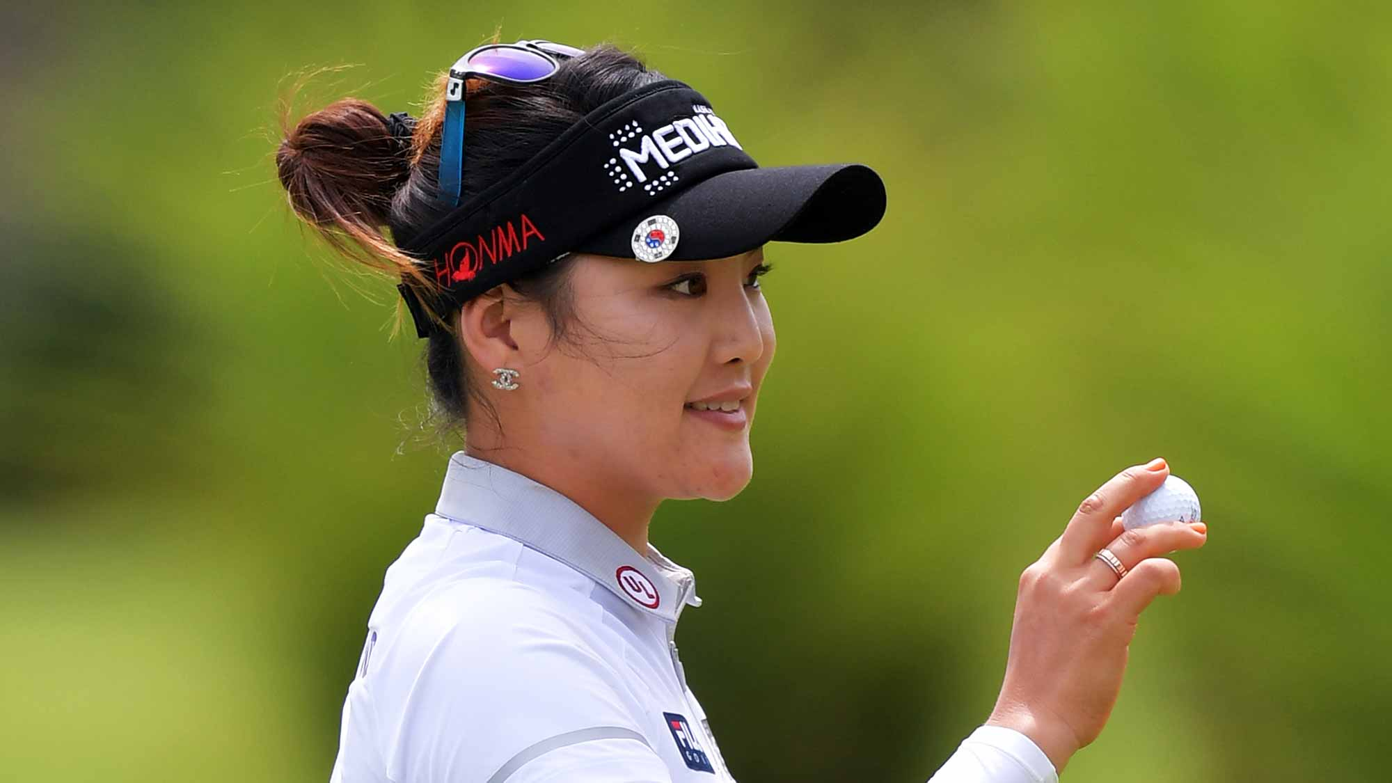 So Yeon Ryu of Korea waves her ball to the crowd after a birdie on the first hole during the second round of the Walmart NW Arkansas Championship Presented by P&G